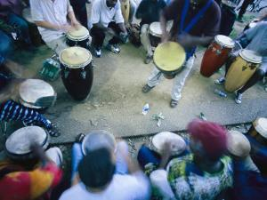 The Blur of a Frenzied Beat in a Circle of Spontaneous Drumming by Stephen St. John