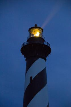 The Cape Hatteras Light Pierces the Night Sky with a Beam by Stephen St. John
