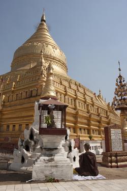 Buddhist Nun Meditating by Gold Stupa, Shwezigon Paya (Pagoda), Nyaung U by Stephen Studd