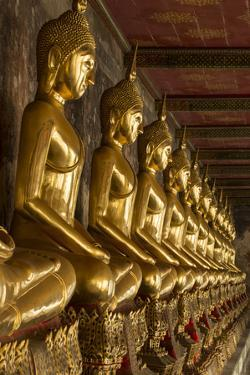 Rows of Gold Buddha Statues, Wat Suthat Temple, Bangkok, Thailand, Southeast Asia, Asia by Stephen Studd