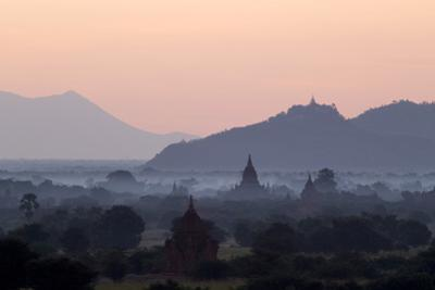 Temples, Pagodas and Stupas in Early Morning Mist at Sunrise, Bagan (Pagan), Myanmar (Burma) by Stephen Studd