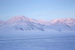View Towards Dirigenten Mountain and Tenoren across Adventdalen Valley at Sunset by Stephen Studd