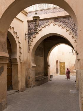 Woman in Traditional Dress Walking in Narrow Side Streets, Old Quarter, Medina, Marrakesh, Morocco by Stephen Studd