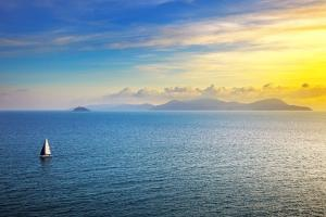 Elba Island Sunset View from Piombino an Sail Boat. Mediterranean Sea. Italy by stevanzz