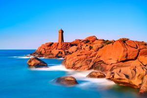 Ploumanach Lighthouse Sunset in Pink Granite Coast, Brittany, France. by stevanzz