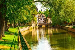Strasbourg, Water Canal in Petite France Area. Half Timbered Houses and Trees in Grand Ile. Alsace, by stevanzz