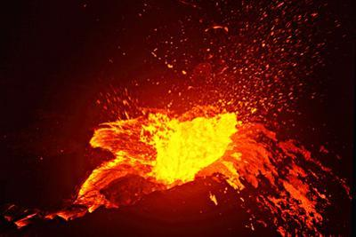 A Lava Bubble Bursts on the Side Wall of a Perched Pond in a Lava Lake