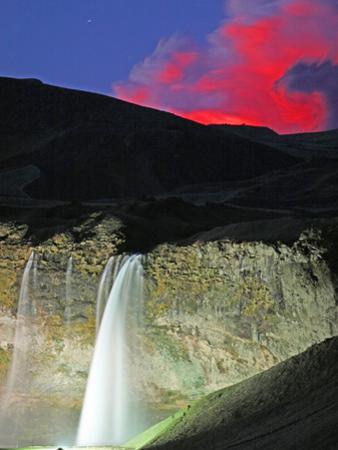 Eyjafjallajokull Volcano Erupting Behind Seljalandsfoss Waterfall, Iceland