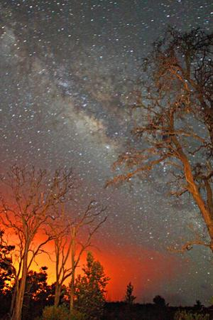 The Milky Way Shines As the Glow of Lava Light Reflects in the Sky