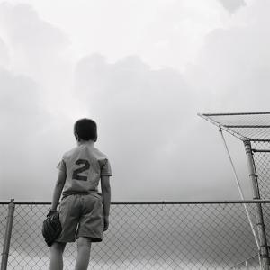 Boy in baseball uniform by Steve Cicero