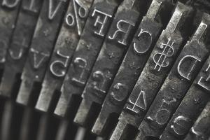 Old Typewriter Type Focus On Money Symbol by Steve Collender
