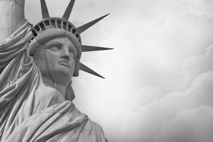 Statue Of Liberty Against Rain Clouds In Black And White by Steve Collender
