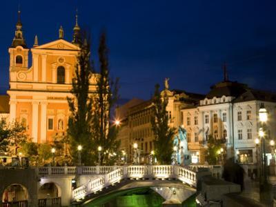 Evening View of Franciscan Church, Presernov Trg Square and Triple Bidge, Ljubljana, Slovenia by Steve Outram
