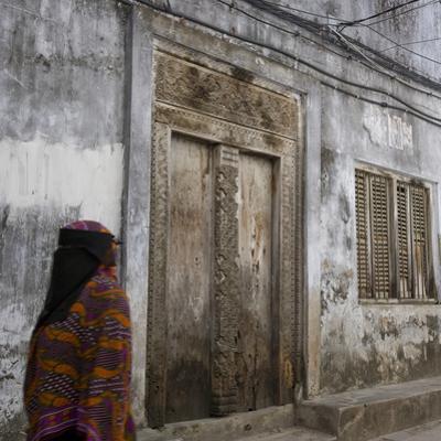 Zanzibar, Tanzania. a Zanzibari Women in Traditional Khanga Robes, Passing an Old Wooden Door in St by Steve Outram