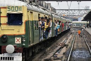 A passenger train arrives at Howrah Station in Calcutta. by Steve Raymer