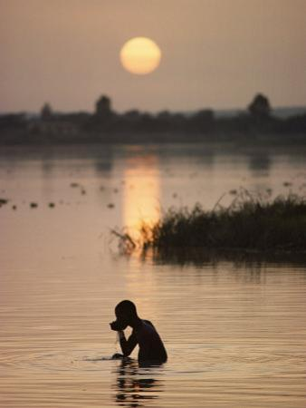 Person Bathing in the Niger River by Steve Raymer