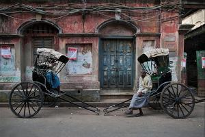 Rickshaw Pullers Pause for a Break on a Kolkata Side Street by Steve Raymer