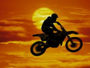 Digital Composite of Motocross Racer Doing Jump by Steve Satushek