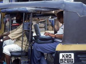 Man Uses Laptop in Back Seat of Rickshaw, India by Steve Starr