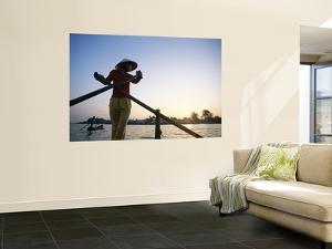 Boat Woman on Mekong River / Sunrise, Cantho, Mekong Delta, Vietnam by Steve Vidler