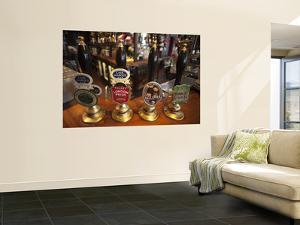 England, London, Beer Pump Handles at the Bar Inside Tradional Pub by Steve Vidler