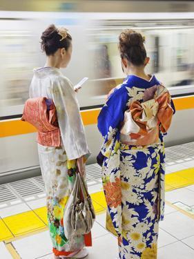 Japan, Tokyo, Girls in Kimono on Subway Platform by Steve Vidler