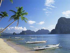 Outriggers at El Nido, Bascuit Bay, Palawan, Philippines by Steve Vidler