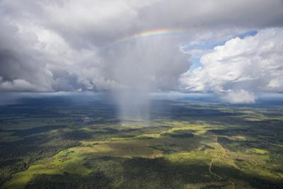 A rainbow over Colombia's Chiribiquete National Park. by Steve Winter