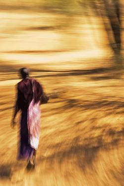 An African Masai Tribesman Walking with Motion Blur by Steven Boone