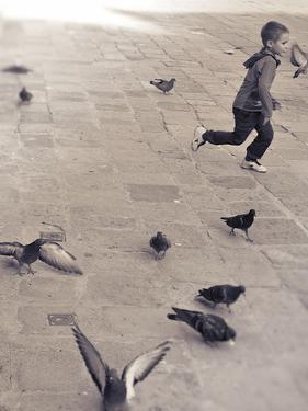 Child Running across Stones, Venice, Italy by Steven Boone