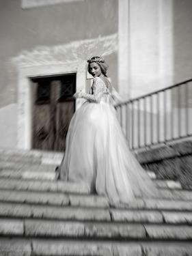 Young Adult Female in Long Wedding Dress Standing on Steps by Steven Boone