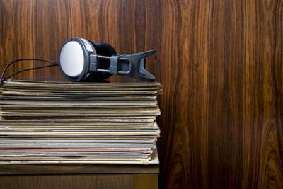 Headphones Laying on Stack of Vinyl Records by Steven Errico