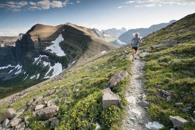 A Woman Trail Running High in Glacier National Park, Montana by Steven Gnam