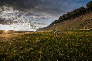 A Woman Trail Running in Glacier National Park, Montana by Steven Gnam