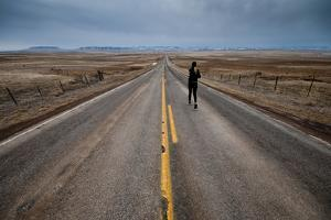 A Young Woman Approaching the Rocky Mountain Front, Teton County, Montana by Steven Gnam