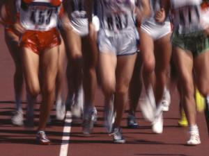 Blurred Action of Women Runners During a Track Race by Steven Sutton
