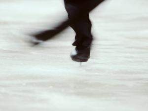 Detail of Male Figure Skater's Legs and Boots Spinning by Steven Sutton