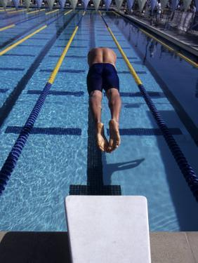Swimmer Diving Off the Starting Blocks to Begin a Race by Steven Sutton