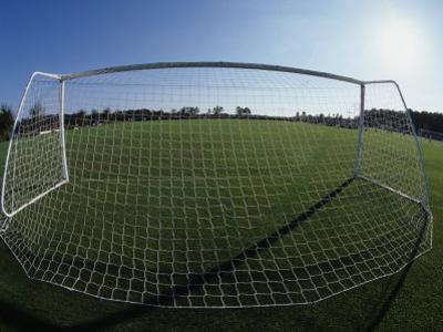View of Soccer Field Through Goal by Steven Sutton