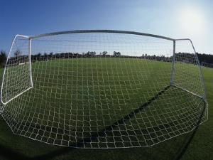 View of Soccer Field Through Goal by Steven Sutton