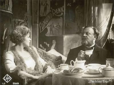 https://imgc.allpostersimages.com/img/posters/still-from-the-film-the-blue-angel-with-marlene-dietrich-and-emil-jannings-1930_u-L-PJJCPI0.jpg?artPerspective=n