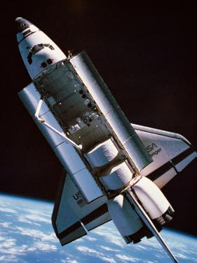 The Space Shuttle with Cargo Bay Open Orbiting above Earth by Stockbyte