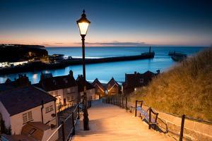 199 Steps of Whitby in the North Yorkshire at Sunset , United Kingdom by stocker1970