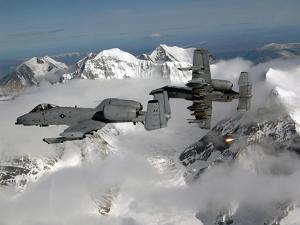 A-10 Thunderbolt II's Fly Over Mountainous Landscape by Stocktrek Images