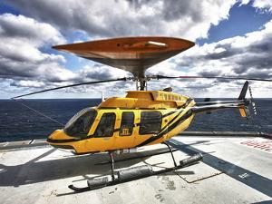 A Bell 407 Utility Helicopter On the Helipad of An Oil Rig by Stocktrek Images