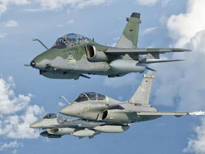 A Brazilian Air Force Embraer A-1B, French Air Force Rafale, and US Air Force F-16C Fighting Falcon by Stocktrek Images