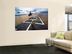 A Brazilian Eurocopter Prepares to Land Aboard a Brazilian Navy Hospital Ship by Stocktrek Images