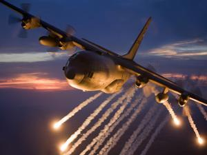 A C-130 Hercules Releases Flares During a Mission Over Kansas by Stocktrek Images