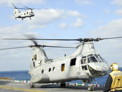 A CH-46E Sea Knight Helicopter Takes Off from the Flight Deck of USS Essex by Stocktrek Images