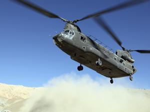 A CH-47 Chinook Prepares to Land by Stocktrek Images